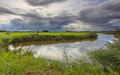 River with Dramatic Clouds In Friesland, Netherlands - PhotoDune Item for Sale