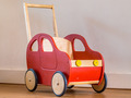 Red Wooden Toy Bike in a living room - PhotoDune Item for Sale