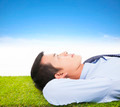 young businessman lying on a meadow and contemplating - PhotoDune Item for Sale