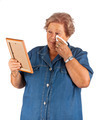 Old lady crying watching a blank photo frame - PhotoDune Item for Sale