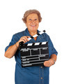 Elderly woman with clapper board - PhotoDune Item for Sale