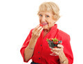 Fit Healthy Senior Lady Eating Berries - PhotoDune Item for Sale