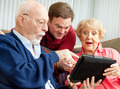 Seniors and Adult Son with Tablet PC - PhotoDune Item for Sale