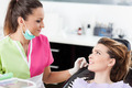 Woman dentist talking to her patient - PhotoDune Item for Sale