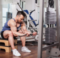 Athletic man pulling up heavy weights at the gym - PhotoDune Item for Sale