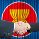 ASEAN Economic Community in businessman handshake - PhotoDune Item for Sale