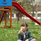 little girl sitting on grass and eat ice cream - PhotoDune Item for Sale