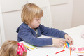 LIttle Boy Drawing with Colored Crayons - PhotoDune Item for Sale