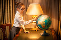 Young schoolgirl studying globe - PhotoDune Item for Sale