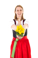 Beautiful woman in dirndl giving bunch of roses - PhotoDune Item for Sale