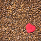 Red heart on coffee beans background - PhotoDune Item for Sale